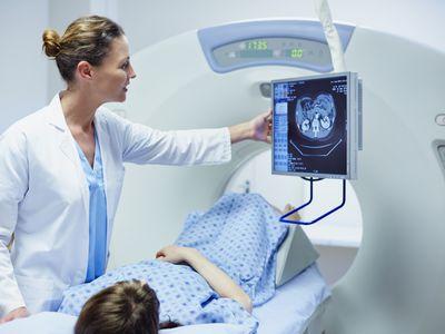 Doctor showing patient CT scan imaging