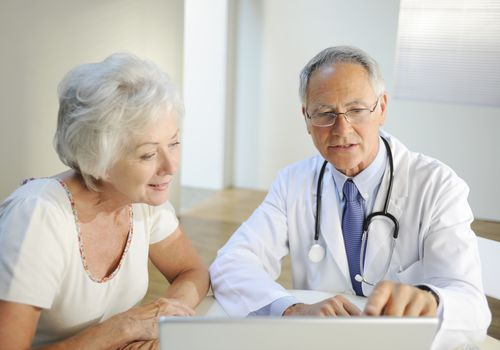 Older woman listening to doctor