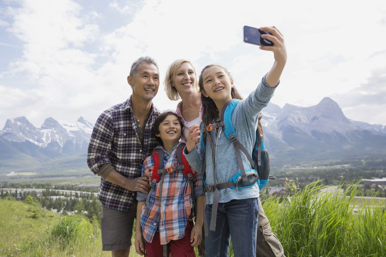 Family taking a selfie with a mountain range in the distance
