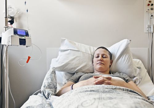 Cancer patient laying in her hospital bed