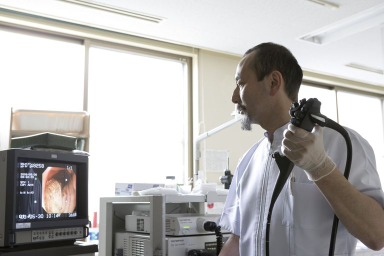 Doctor holding endoscope
