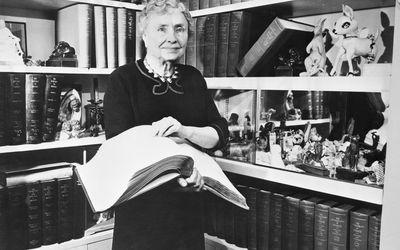 Helen Keller Reading Braille