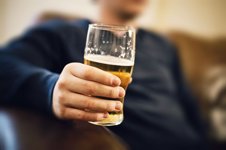 Man with a beer in hand