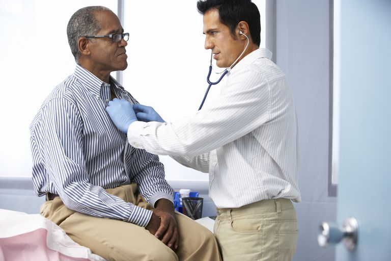 Doctor performing heart checkup on patient