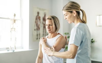 Physiotherapy worker with woman client