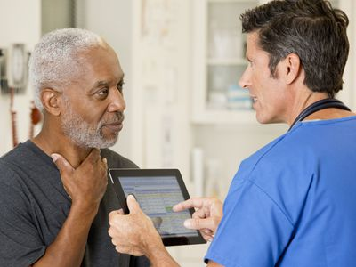 A man talking to his doctor about his throat