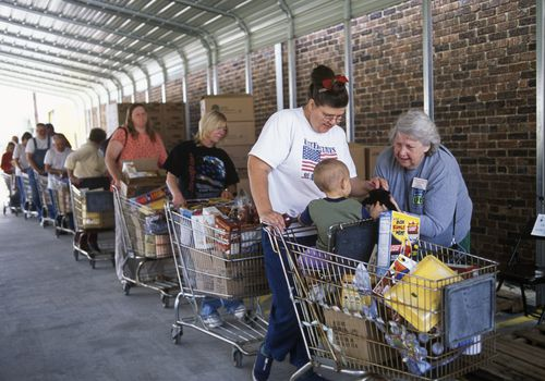 People standing in line at a food bank.