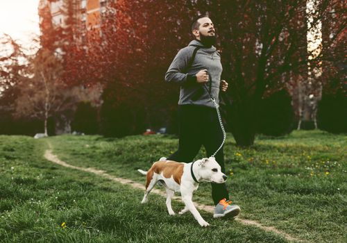 Man jogging with his dog