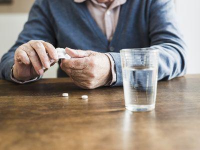 Senior taking zinc tablets