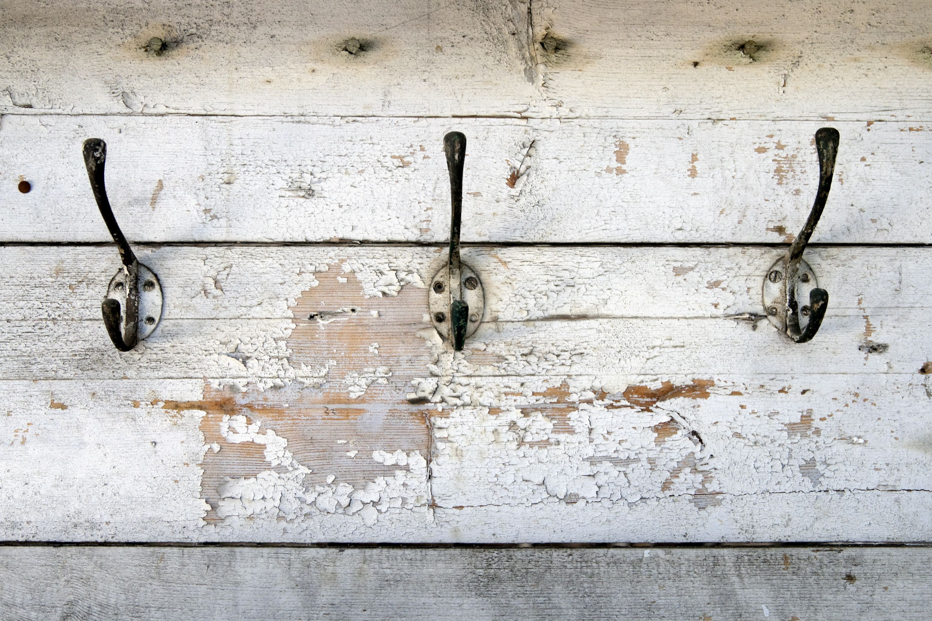 Coat hooks on a rustic wood plank wall
