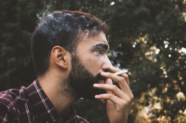 Close-Up Of Young Man Smoking Outdoors