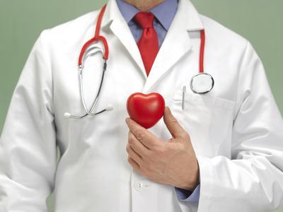 healthcare provider holding heart