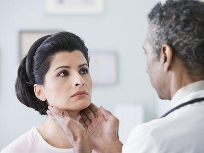 women having thyroid examined