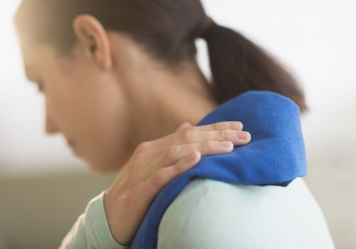 Woman icing her shoulder.