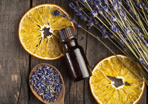 Orange essential oil laying on a table