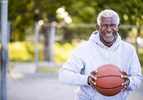 senior man with basketball