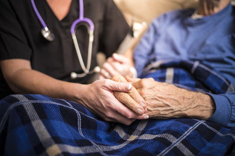 Hospice Nurse visiting an elderly patient