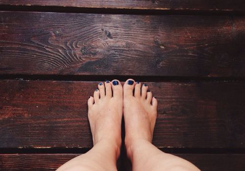 Woman's feet with toenails painted blue