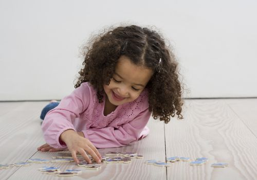 Child Doing Jigsaw Puzzle