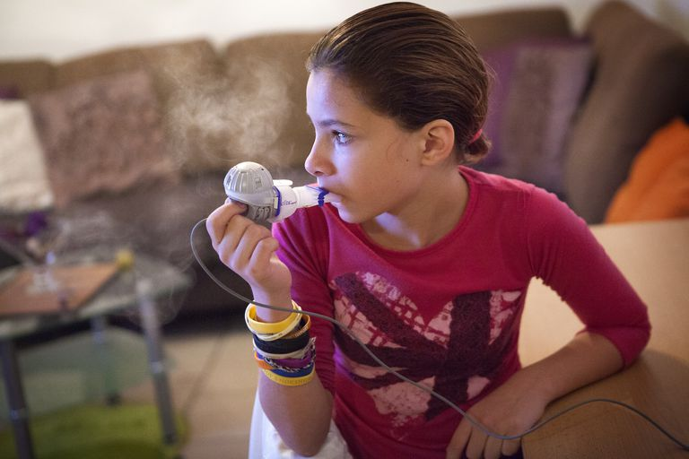 Girl using a nebulizer