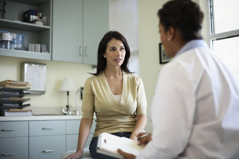 Woman talking to female doctor