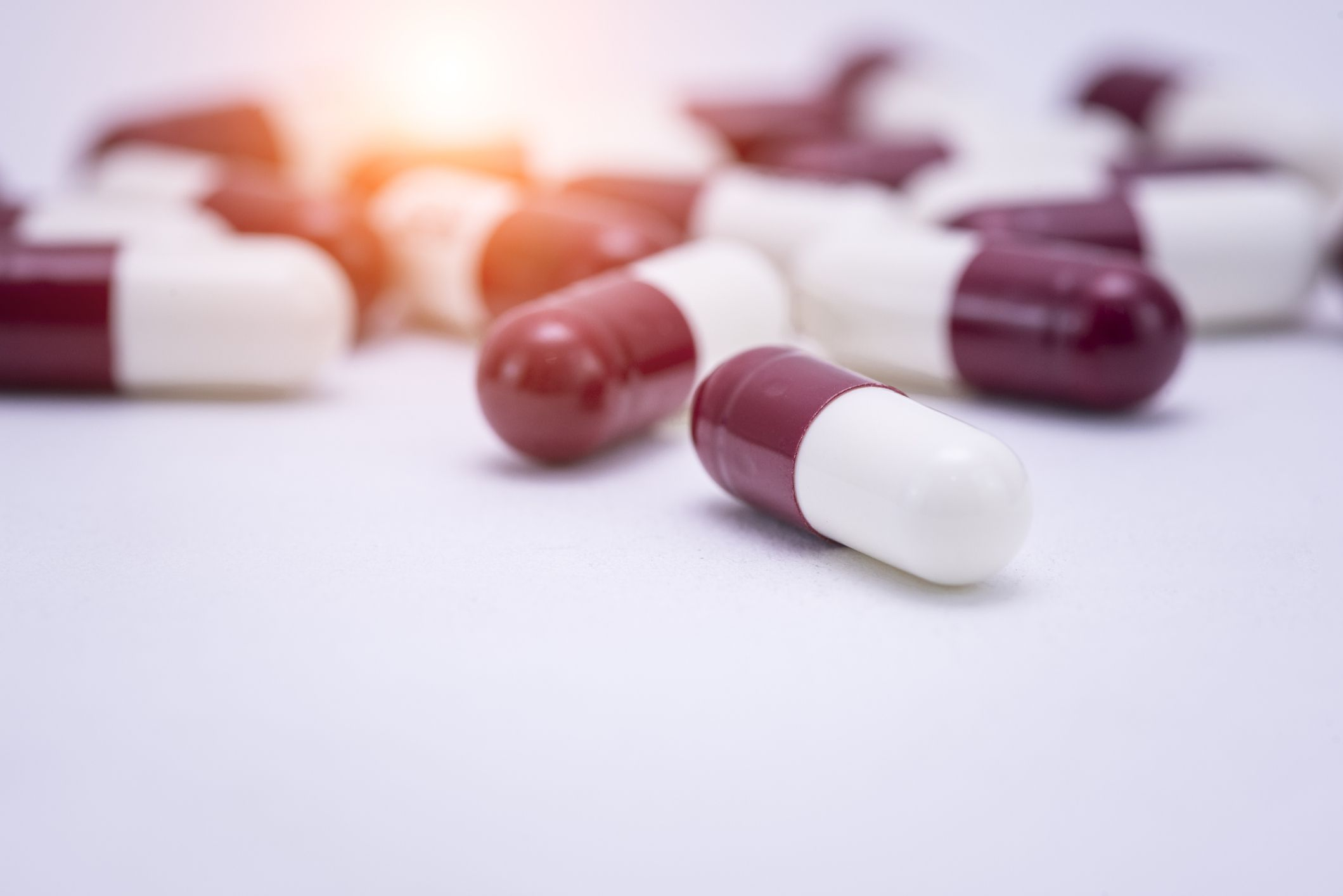 Close up of capsules on a white background