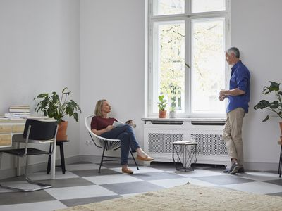 Mature couple talking at home