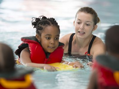 Swimming instructor with kids