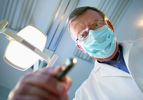 dentist working - from the perspective of a patient