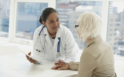 Doctor performs neurological exam with senior patient