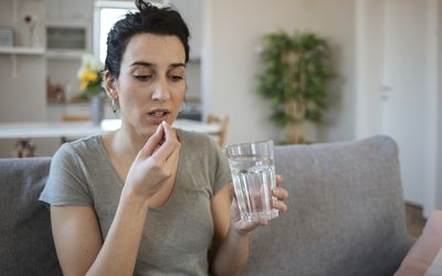 woman taking medication for infertility