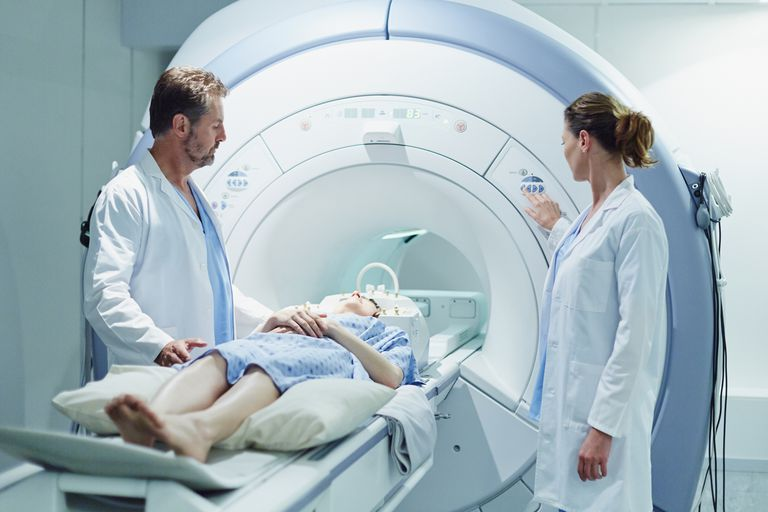 An MRI test with a patient and two doctors