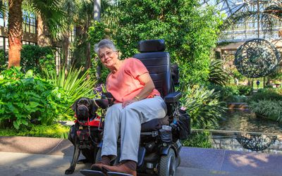 A woman with progressing-relapsing MS using an electric scooter