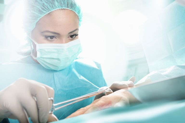 female surgeon operating