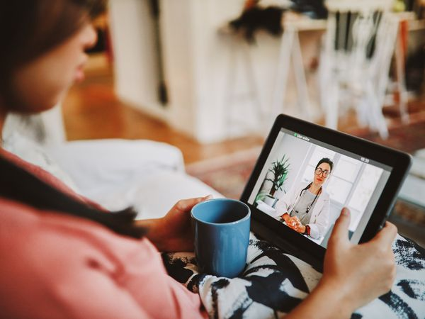 Woman having an online telemedicine discussion with her doctor