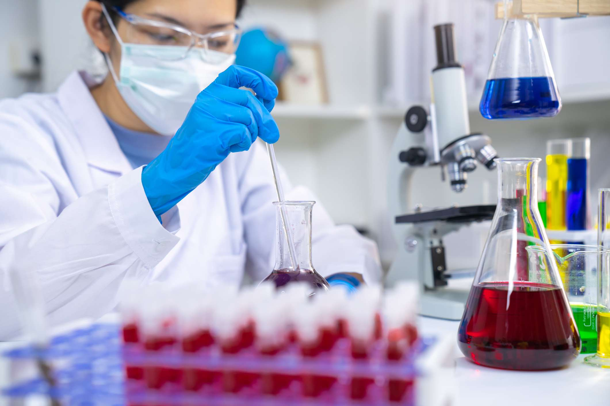 A lab technician prepares samples for polymerase chain reaction (PCR) testing.