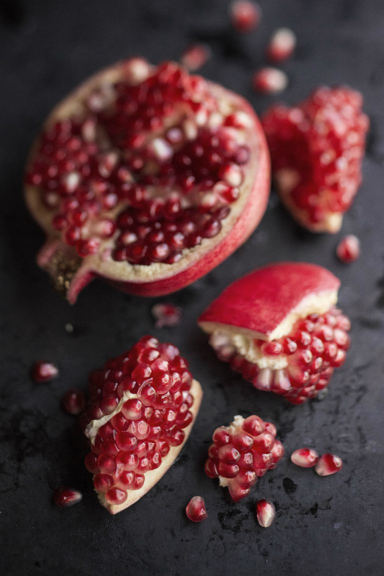 Opened pomegranate and seeds