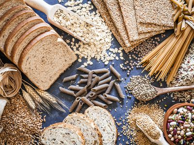 Top view of wholegrain and cereal composition shot on rustic wooden table.