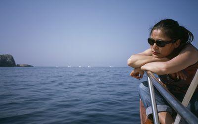 Woman seasick on a boat