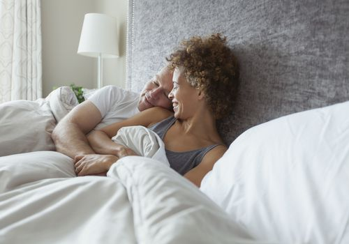 Couple together in bed