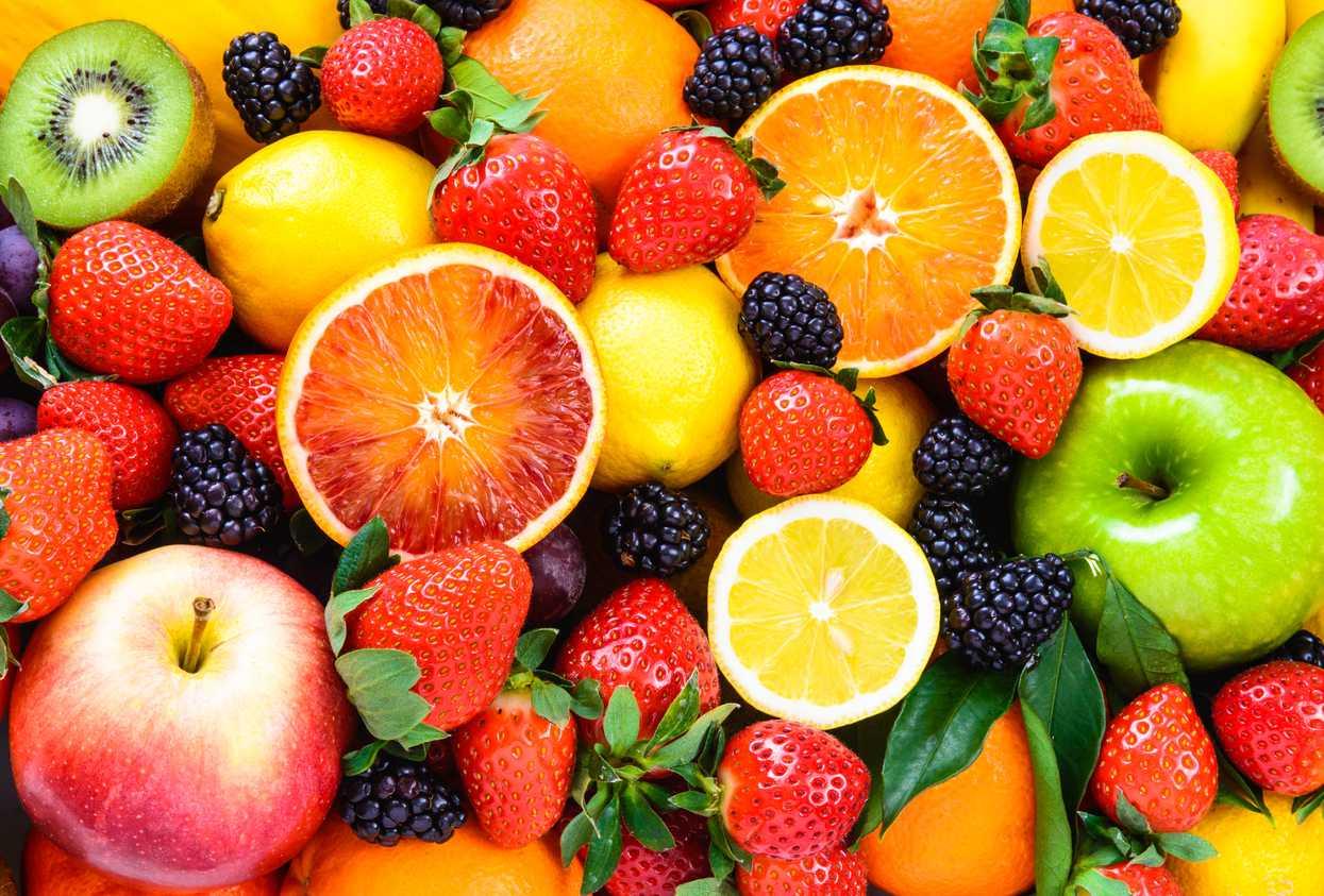 Fresh fruit including strawberries, lemonds, blackberries, apples, and grapefruit