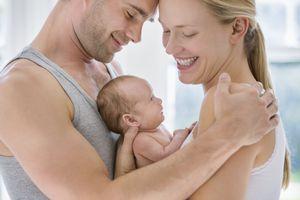 Parents cradling newborn baby