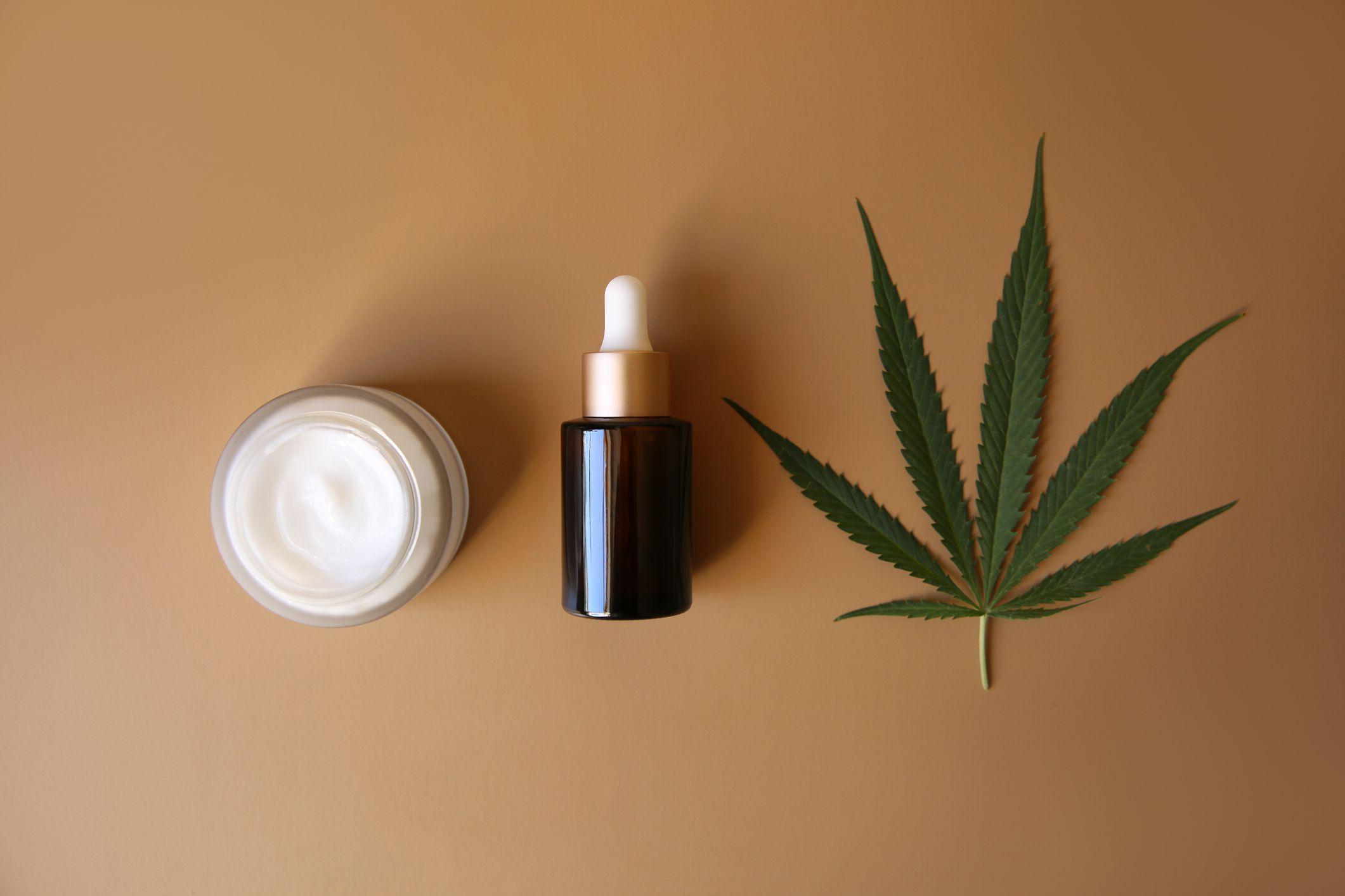 medicinal cream with CBD oil, bottle of cannabis oil, capsule