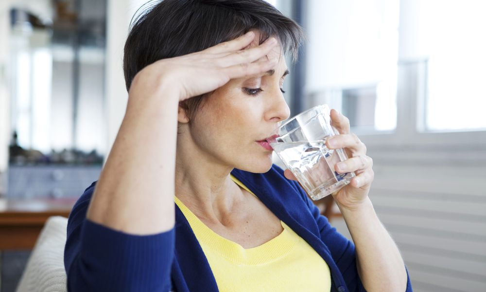 Woman with menopause drinking water