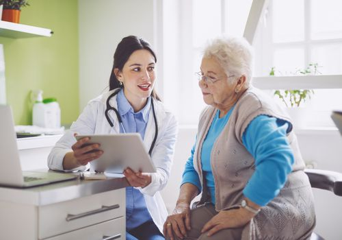 Doctor consulting an older patient.