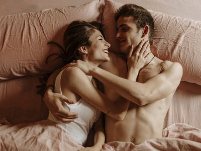 Man and woman in bed smiling
