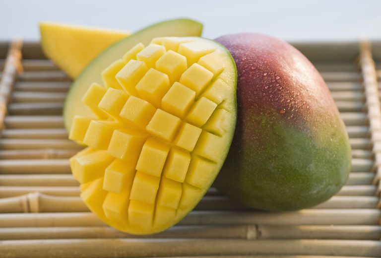 Cut mango on bamboo tray