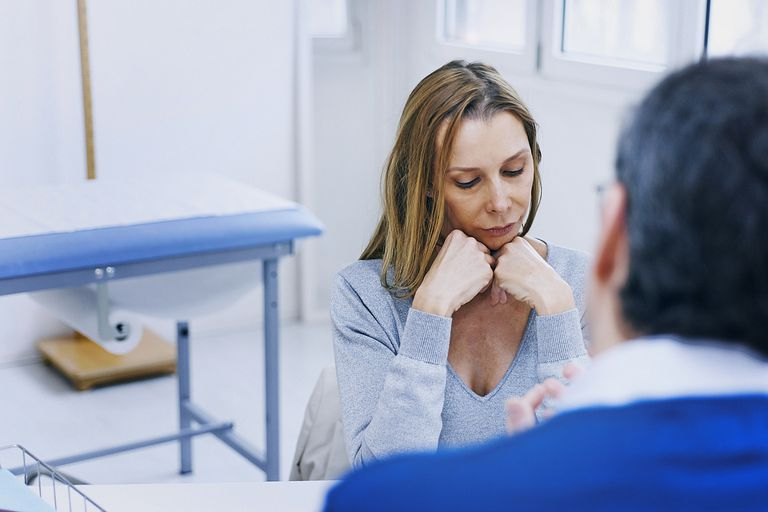 Woman In Consultation with Doctor
