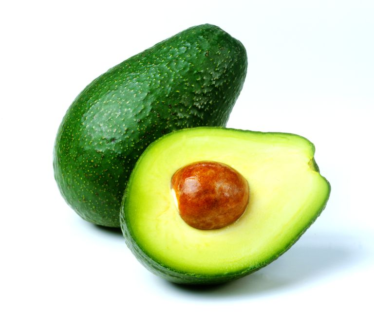 Whole and cut avocado