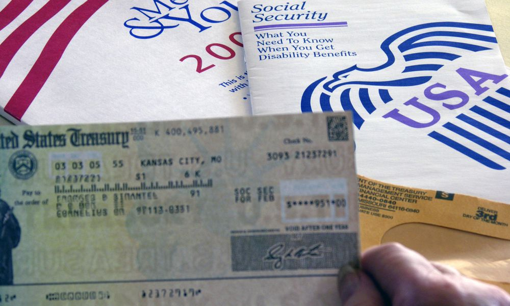 a person holding a social security check